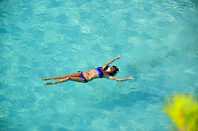 Woman floating in the sea I - p885m858309 by Oliver Brenneisen