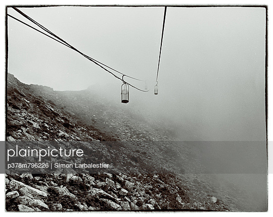 Cable chairs in mist - p378m796226 by Simon Larbalestier