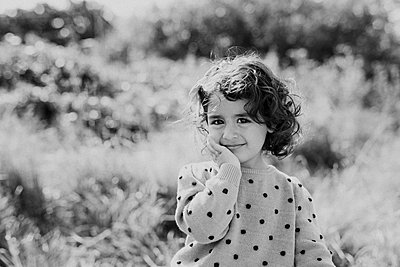 Smiling girl looking at camera - p312m2249750 by Anna Johnsson