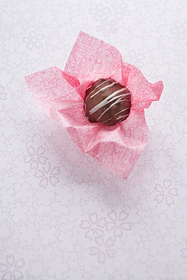 Chocolate in pink paper - p4641032 by Elektrons 08