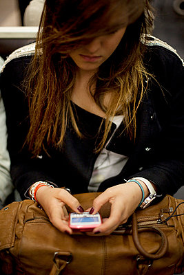 Young woman with mobile phone - p4451005 by Marie Docher