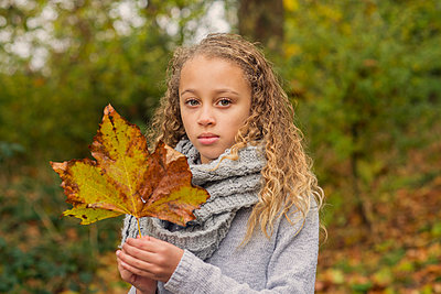 Portrait of a girl in a park, Autumn - p1323m1190224 by Sarah Toure