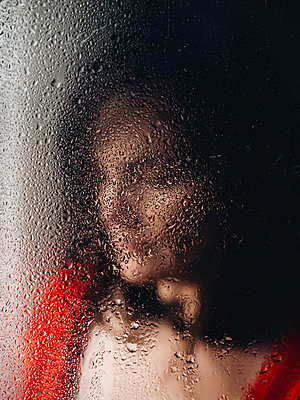 Portrait woman behind wet glass - p1522m2151169 by Almag