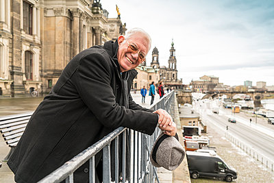 Germany, Dresden, happy senior man standing on Bruehl's Terrace - p300m1156826 by A. Tamboly