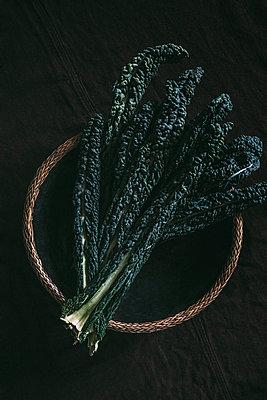Kale leaves,  studio shot - p312m2162288 by Rania Rönntoft