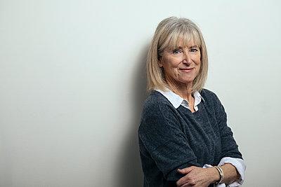 Portrait smiling, confident senior woman - p1192m1529898 by Hero Images