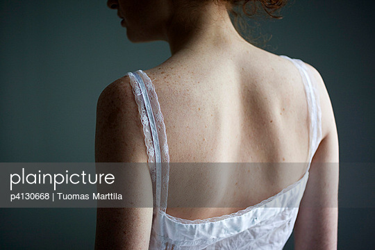 Woman with freckles - p4130668 by Tuomas Marttila
