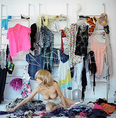 A woman trying on some clothes - p1610m2257901 by myriam tirler