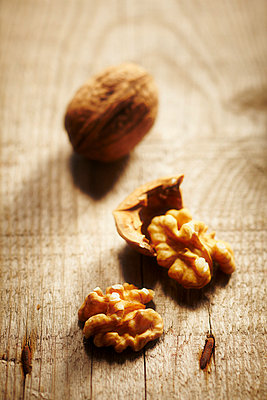 Walnuts on a wooden table - p968m658842 by roberto pastrovicchio