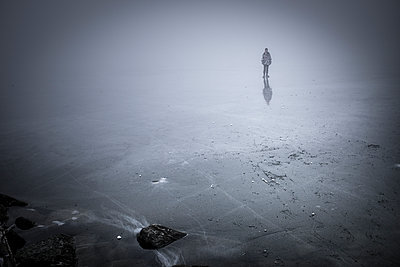 Walking on frozen lake - p1007m1134074 by Tilby Vattard