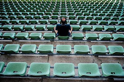 Single man on tribune in football stadium, Friedrich-Ludwig-Jahn-Sportpark - p1093m2193634 by Sven Hagolani