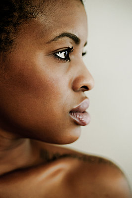 Profile of serious Black woman - p555m1301718 by Peathegee Inc