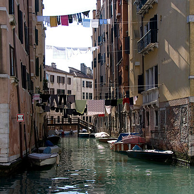 Laundry hangs in residential canal, Cannaregio, Venice. - p8552328 by Mike Burton