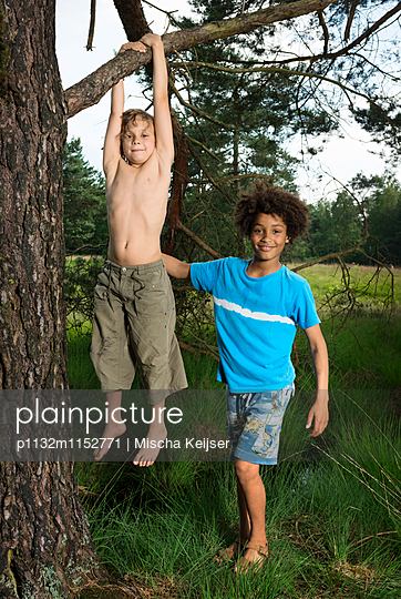 Kids play in the woods - p1132m1152771 by Mischa Keijser