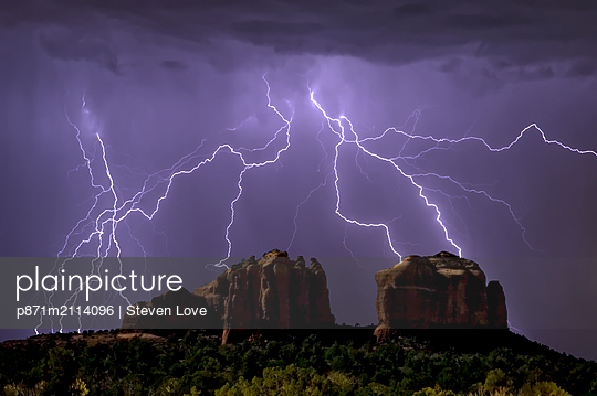 Lightning storm striking Cathedral Rock in Sedona viewed from the Little Horse Trail, Sedona, Arizona, United States of America, North America - p871m2114096 by Steven Love