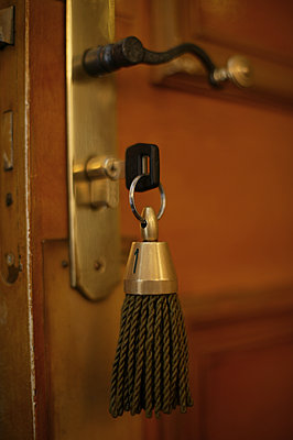Hotel room key in door - p1365m1222921 by John Heseltine