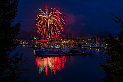 Fireworks explode over the docks at the Port of Ilwaco; Ilwaco, Washington, United States of America - p442m1180104 by Robert L. Potts