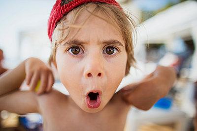 Portrait of little boy pulling funny faces - p300m2041720 by Nasos Zovoilis