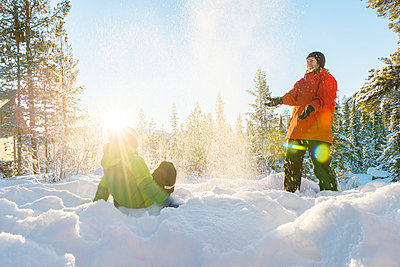 Mother with son playing at winter - p312m1011801f by Mikael Svensson