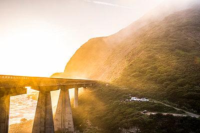 Fog on bridge near ocean - p555m1482060 by Adam Hester