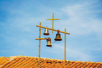 Bells and Crosses at the top of a church. Haute-Loire. France - p813m1462111 by B.Jaubert