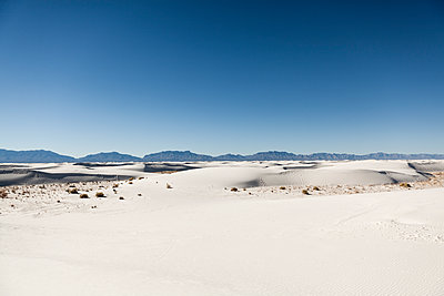 Scenic view of sand dunes at White Sands National Monument against clear blue sky - p1094m1209083 by Patrick Strattner