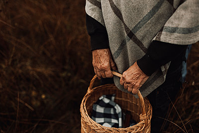 Woman carrying wicker basket - p312m2191326 by Jennifer Nilsson