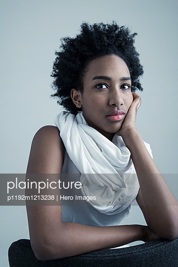 Portrait serious African American teenage girl with curly black hair - p1192m1213238 by Hero Images