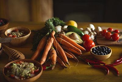Fresh organic vegetables on table - p1315m1484205 by Wavebreak