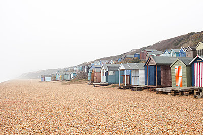 Beach huts in a row on pebble beach - p429m824436 by Franck Sauvarie