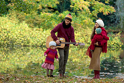 Family in autumn - p402m721255 by Ramesh Amruth