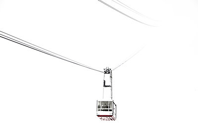 View of a gondola lift in fog - p1025m788849f by Nicklas Blom