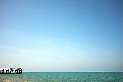 Seascape view with wooden pier, Normandy, France - p429m1014359 by Kathleen Finlay