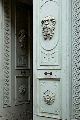 Old entrance door with decoration - p919m1110780 by Beowulf Sheehan