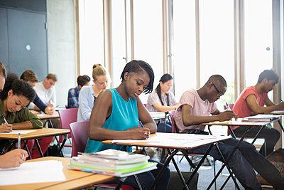 University students taking exam at classroom - p1023m987097f by David Schaffer