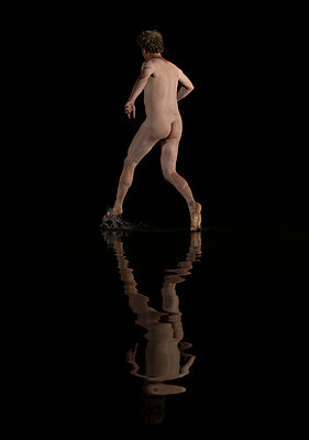 Naked man running on shallow water - p1132m2215541 by Mischa Keijser
