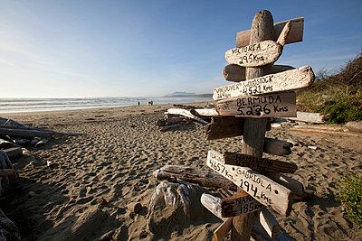 A Destination Distance Sign On Wickaninnish Beach In Pacific Rim National Park Near Tofino; British Columbia Canada - p442m700404 by Deddeda