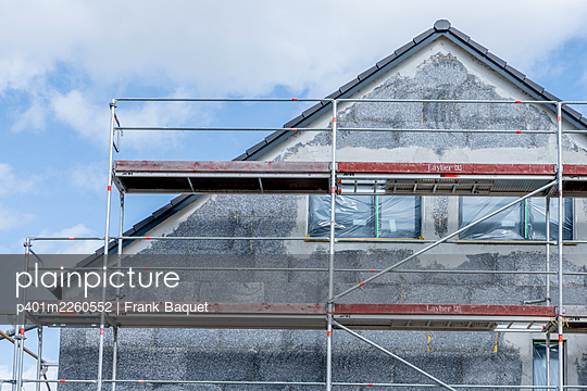 Roof gable with scaffolding - p401m2260552 by Frank Baquet