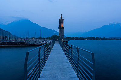 Italy, Lombardy, Province Como, Gera Lario, Lake Como, Harbour with Madonna statue in the evening - p300m941026f by Andreas Pacek