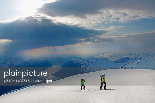 People skiing in winter landscape