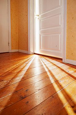Light coming through open door - p312m1113879f by Jan Tove