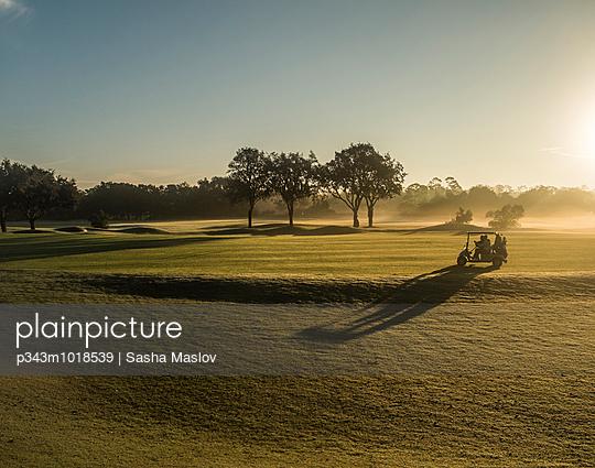 Sunrise on a golf course - p343m1018539 by Sasha Maslov