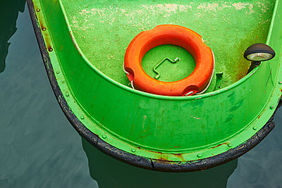 Life-saver on a green boat - p1312m1575169 by Axel Killian
