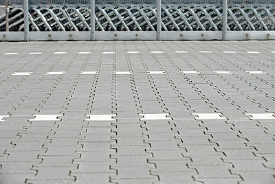 Pavement of a parking place with shopping carts in the background - p300m2213863 by visual2020vision