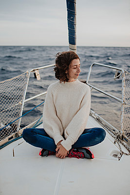 Woman with eyes closed sitting on boat in sea during vacation - p300m2276518 by Gala Martínez López