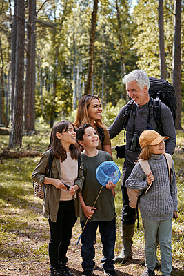 Smiling family in forest - p312m2299590 by Plattform