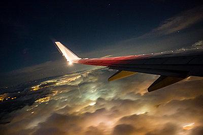 Airplaine approaching John F. Kennedy International Airport at night - p1057m1466826 by Stephen Shepherd