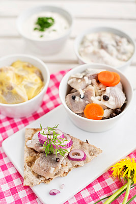 Herring dishes on table - p312m1550744 by Johner
