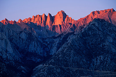 Scenic view of rock mountains against clear sky during sunset - p1166m1518697 by Cavan Images