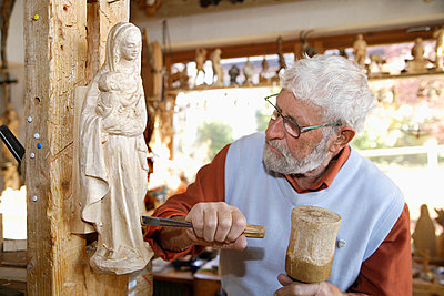 Craftsperson carving statue - p30020402f by Tom Chance